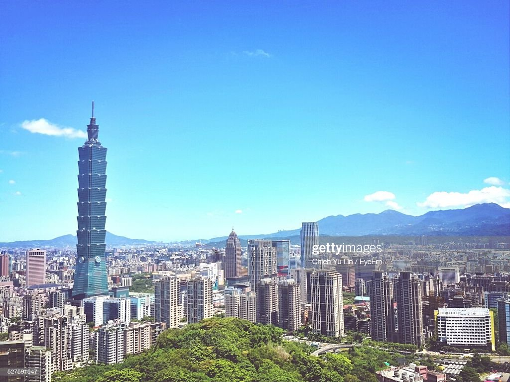 Taipei 101 With Cityscape Against Blue Sky : Stock Photo