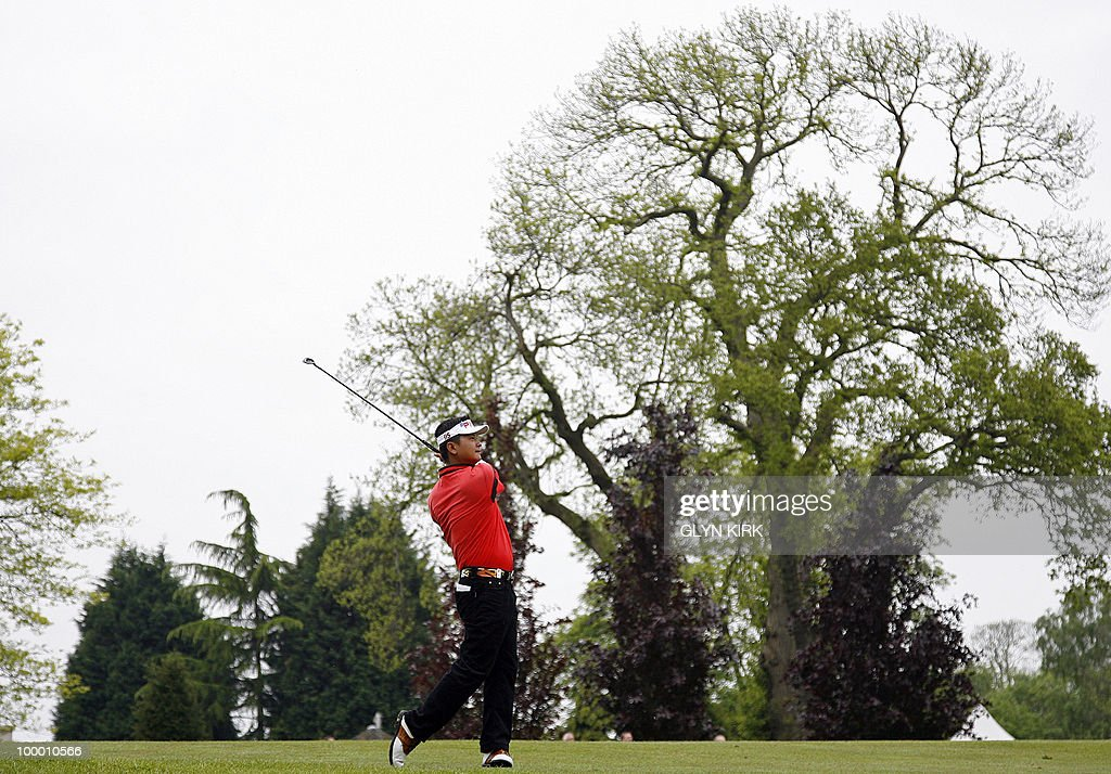 Taipei golfer Wen-Tang Lin watches his approach shot to the 1st green on the first day of the PGA Championship on the West Course at Wentworth, central England on May 20, 2010.