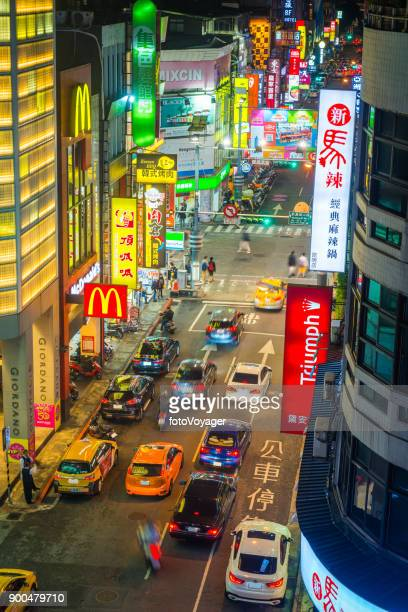 taipei neon night city aerial view traffic highway ximending taiwan - taipei stock pictures, royalty-free photos & images