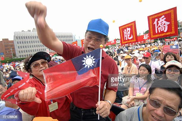 A couple of antiPresident Chen Shuibian showa thumbs down signs during the national day in Taipei 10 October 2006 Hundreds of thousands of protesters...
