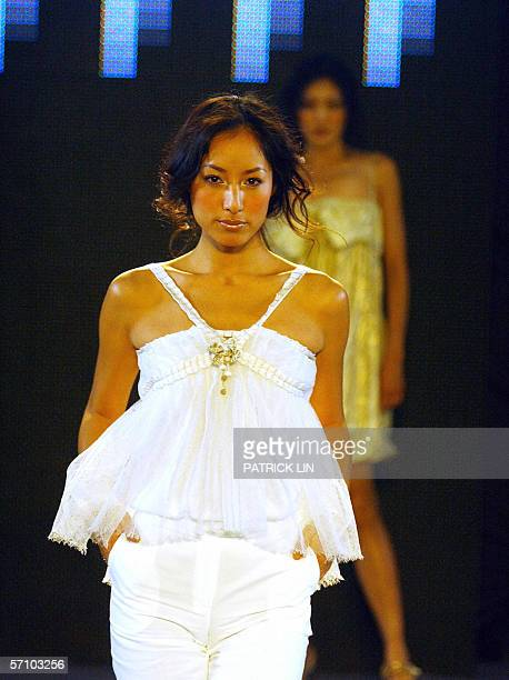 A models walk the ramp during a fashion show preview organized by the management of Taipei 101 the world's tallest skyscraper 16 March 2006 A total...