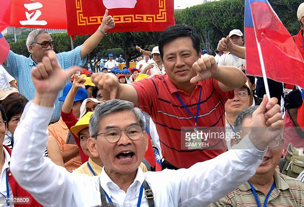 A proPresident Chen Shuibian shows a thumbs up sign while an antiChen's shows thumbs down sign during the national day in Taipei 10 October 2006...