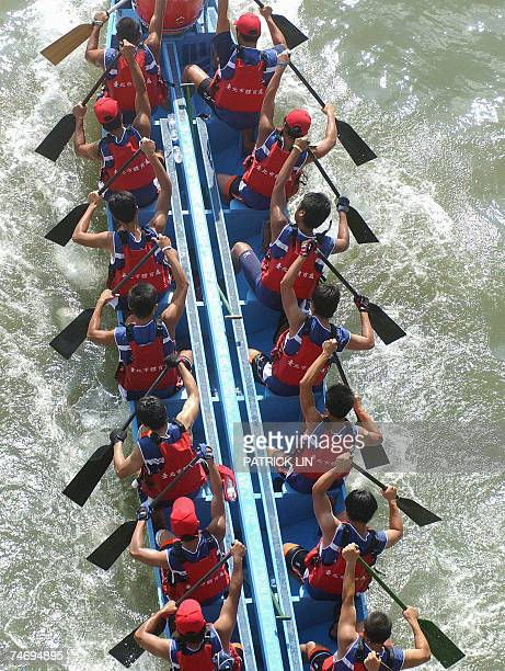 A team paddle in Taipei's 2007 international dragon boat festival 18 June 2007 A total of 124 teams including nine foreign teams joined the threeday...