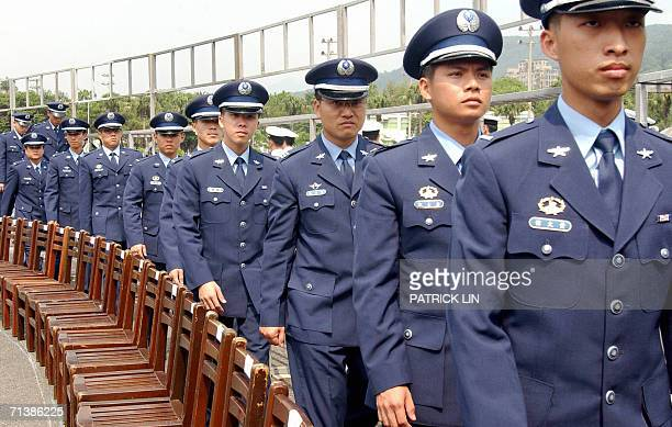 Graduates of Taiwan's air force academy walk past a row of chairs after their graduation ceremony in Taipei 07 July 2006 Taiwan's President Chen...