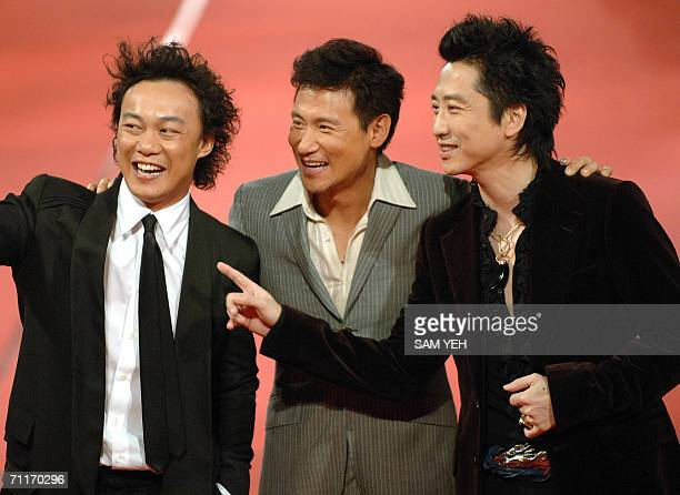 Hong Kong singer Eason Chan Jacky Cheung and Taiwanese singer Harlem Yu pose for a photo on the catwalk during the 17th Golden Melody Awards in...
