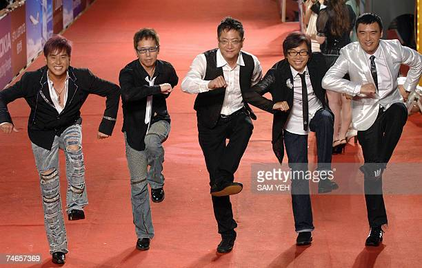 Hong Kong's Winner Five Tigers pose on the red carpet as they arrive for the 18th Golden Melody Awards in Taipei 16 June 2007 Pop singers from Taiwan...