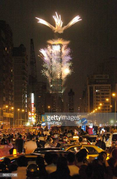 Local residents tare stuck in raffic jams to watch the fireworks on the main street in front of the Taipei 101 a 508meter high building 01 January...