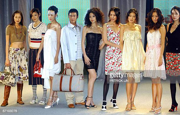 Models walk the ramp during a fashion show preview organized by the management of Taipei 101 the world's tallest skyscraper 16 March 2006 A total of...