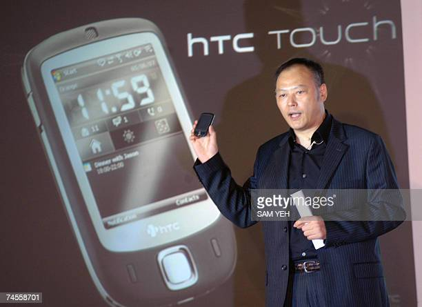 Peter Chou President of Taiwan's leading smart phone High Tech Computer Corporation maker displays a leatest HTC Touch cell phone during a press...