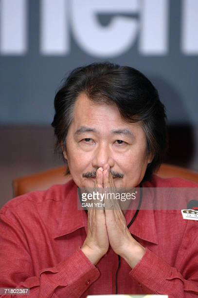 Shih Ming-teh, former chairman of Taiwan's ruling Democratic Progressive Party, gestures while listening to a query raised during a press conference...