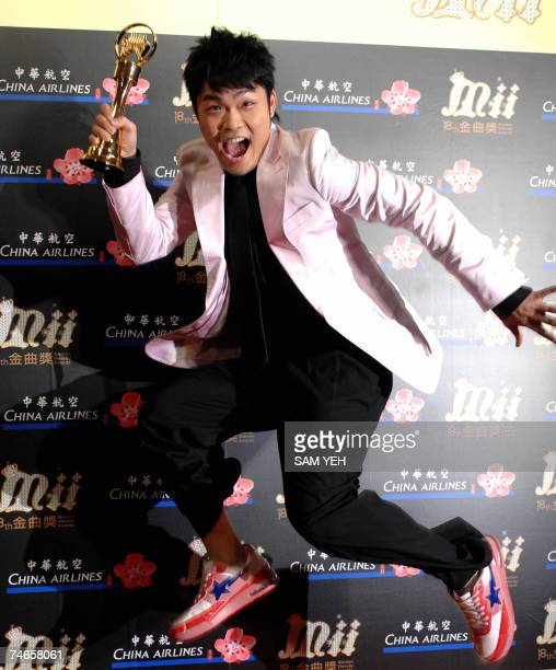 South Korean singer Nicky L jumps in the air for a photo after winning the Best Male VocalistMandarin award during the 18th Golden Melody Awards in...
