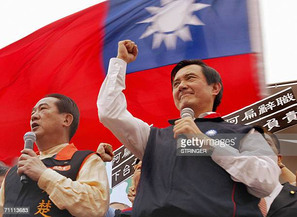 Taiwan main opposition Kuomintang chairman Ma Yingjeou raises his fist in front of a national flag while James Soong chairman of the opposition...