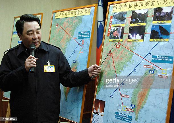 Taiwan's defense ministry spokesman Liou Chihjein during a press conference at Taipei 07 March 2006 shows a map across the Strait as the ministry...