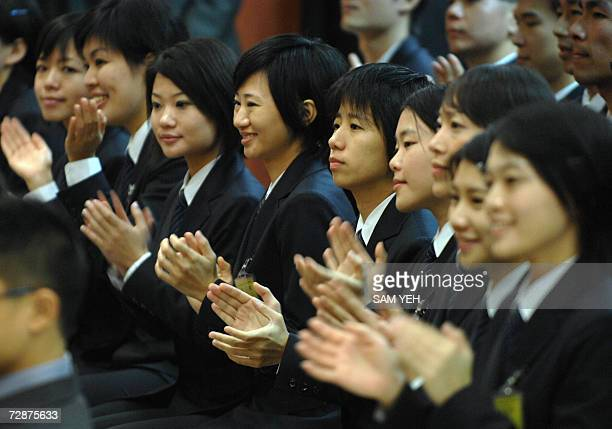 Taiwan's investigation agents clap their hands during the 43th graduation ceremony at the headquarter of Investigation Bureau in Hsintien Taipei...