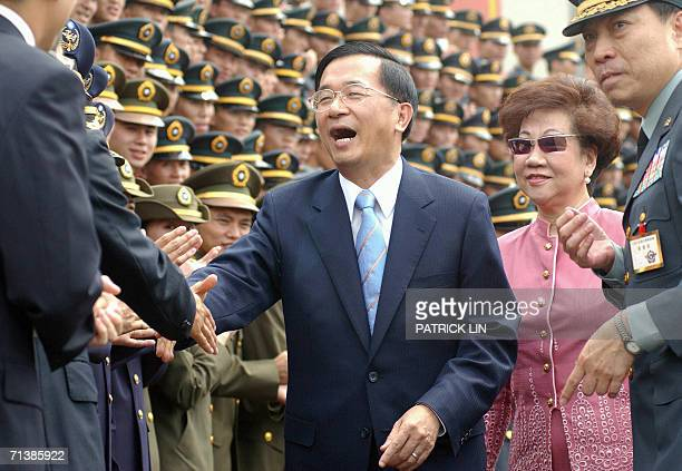 Taiwan's President Chen Shuibian shakes hands with an unidentified official during the joint graduation ceremony of seven military naval and air...