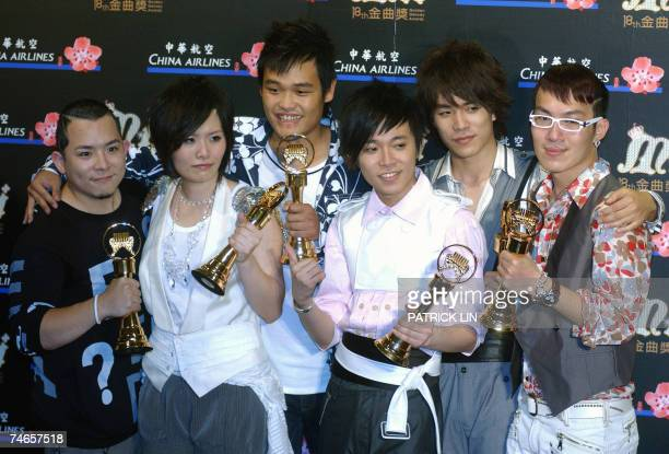 Taiwan's Sodagreen pose after winning the Best Band award during the 18th Golden Melody Awards in Taipei 16 June 2007 Pop singers from Taiwan China...