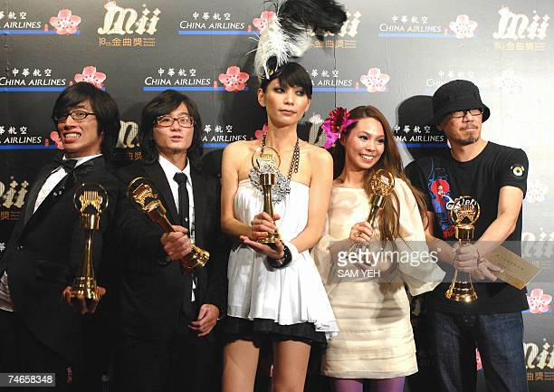 Taiwan's Tizzy Bac pose after winning the Best Album Producer award during the 18th Golden Melody Awards in Taipei 16 June 2007 Pop singers from...