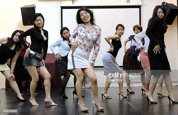 TO GO WITH LIFESTYLETAIWANCULTUREDANCE by Amber Wang Women dance at a dance studio in Taipei 13 May 2007 as part of the 'How to Look and Feel Sexy...
