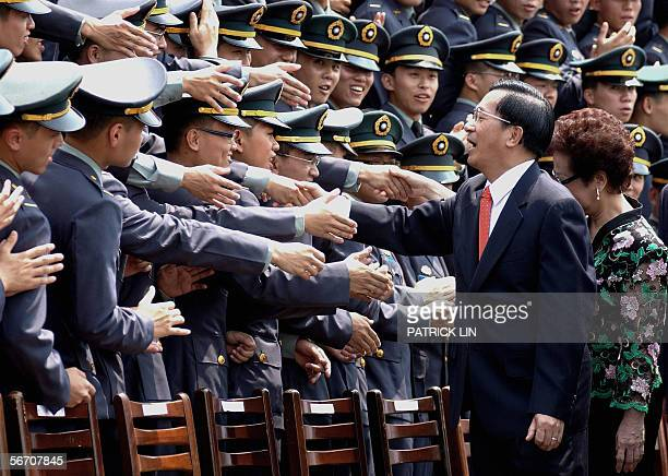 TO GO WITH STORY 'USTAIWANCHINAPOLITICS' This file photo dated 08 July 2005 shows Taiwanese President Chen Shuibian shaking hands with cadets at the...