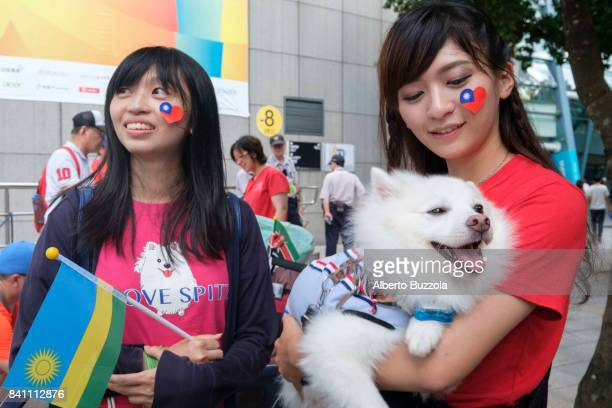 Taipei Universiade 2017 Two young girls outside the Taipei Arena waiting to enter the venue to take part in the closing ceremony of the Taipei...