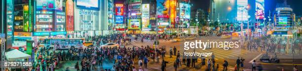 taipei ximending neon night panorama futuristic crowded cityscape taiwan - taiwan stock photos and pictures
