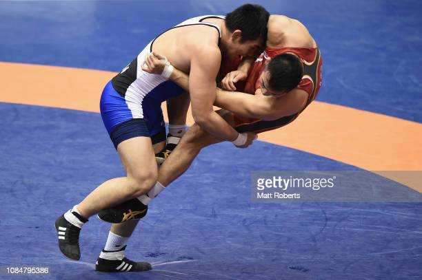 Taira Sonoda competes against Takashi Ishiguro during the men's wrestling 97kg Freestyle match on day one of the Emperor's Cup All Japan Wrestling...
