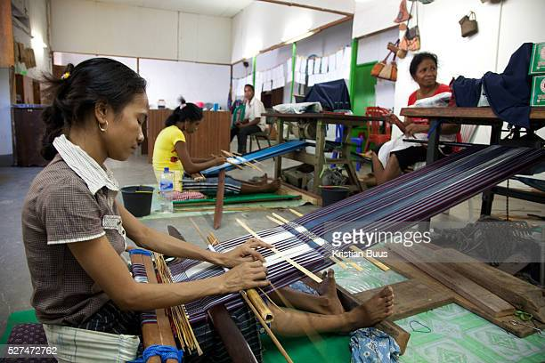 Tais weaved in traditionla fashion The factory has big clients the army the government and big business The factory is run by the Alola Foundation as...