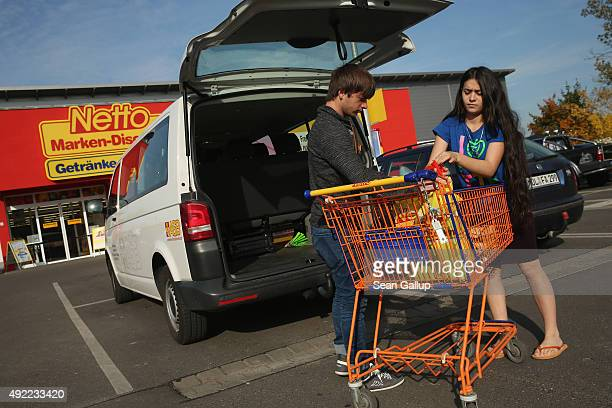 Taisa Umajeva and her brother Ramzan both of them asylum applicants from Chechnya load a van after shopping for groceries with other refugees at a...