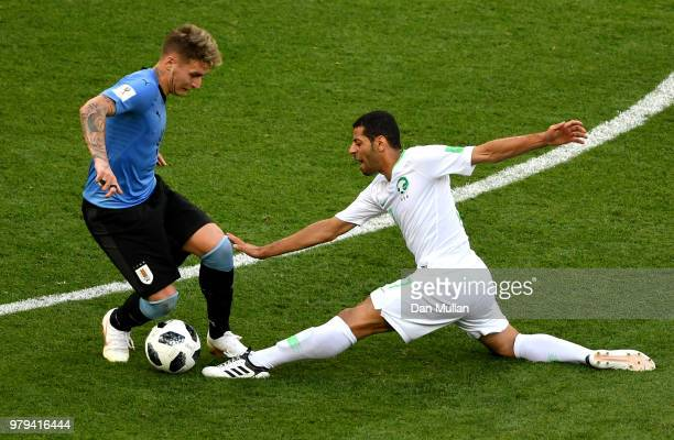 Taiseer Aljassam of Saudi Arabia gets injured while tackling Guillermo Varela during the 2018 FIFA World Cup Russia group A match between Uruguay and...