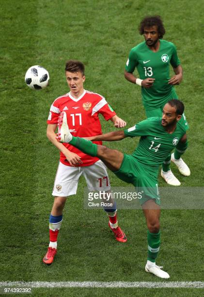 Taiseer Aljassam of Saudi Arabia is tackled by Abdullah Otayf of Saudi Arabia during the 2018 FIFA World Cup Russia Group A match between Russia and...