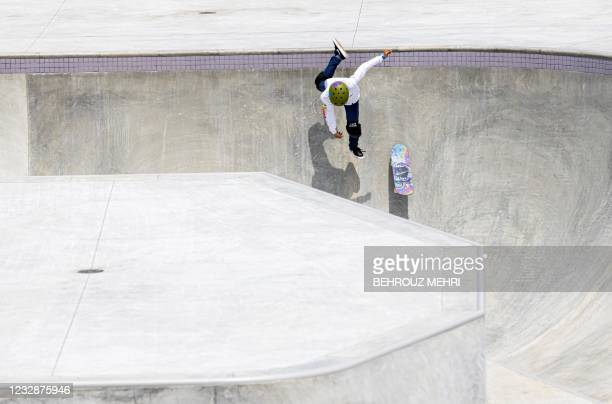 Taisei Kikuchi of Japan warms up in the the skateboarding park category during the skatebording test event for Tokyo 2020 Olympic Games at the Ariake...
