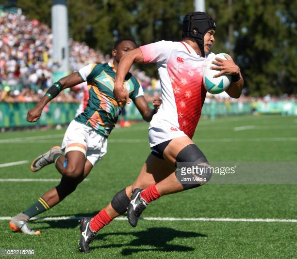Taisei Konishi of Japan evades the tackle by Ofentse Mpho Maubane of South Africa during a match between Japan and South Africa on day 9 of Buenos...