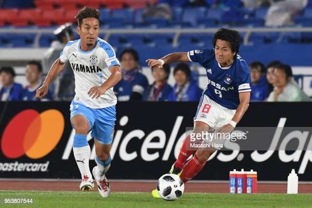 Taishi Taguchi of Jubilo Iwata and Kosuke Nakamachi of Yokohama F.Marinos compete for the ball during the J.League J1 match between Yokohama...