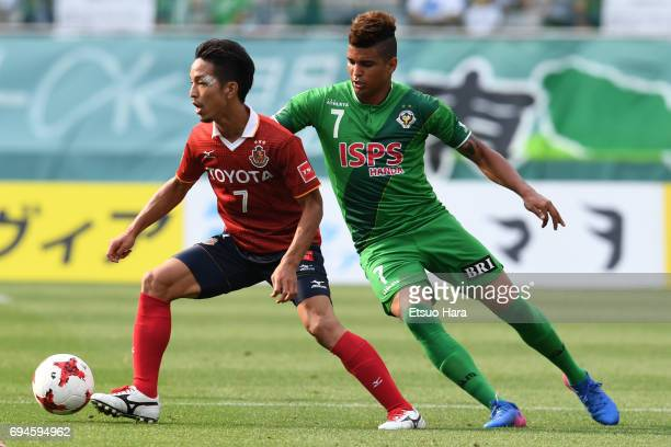 Taishi Taguchi of Nagoya Grampus and Alan Pinheiro of Tokyo Verdy compete for the ball during the J.League J2 match between Tokyo Verdy and Nagoya...
