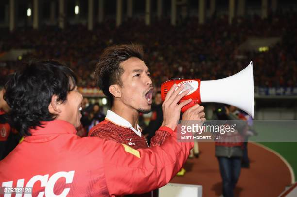 Taishi Taguchi of Nagoya Grampus appluads supporters after his side's 42 victory in the JLeague J1 Promotion PlayOff semi final match between Nagoya...