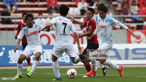 Taishi Taguchi of Nagoya Grampus competes for the ball against Kamatamare Sanuki defense during the J.League J2 match between Nagoya Grampus and...