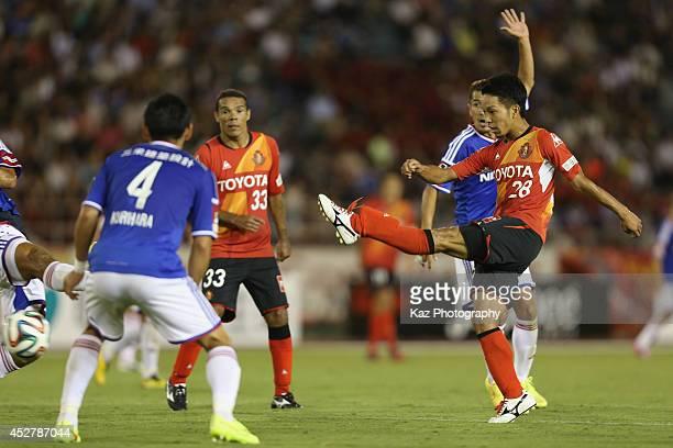 Taishi Taguchi of Nagoya Grampus shoots during the J. League match between Nagoya Grampus and Yokohama F.Marinos at Mizuho Stadium on July 27, 2014...
