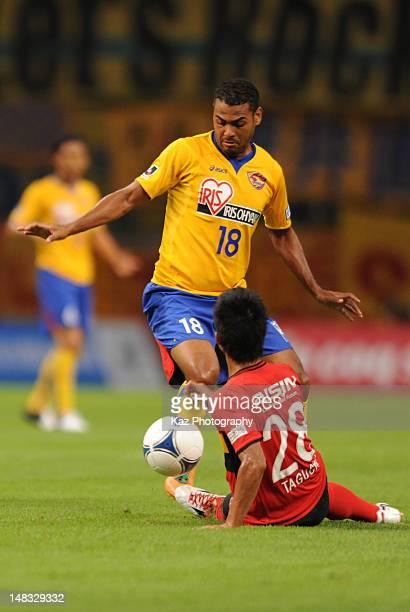 Taishi Taguchi of Nagoya Grampus stops Wilson Rodrigues Fonseca of Vegalta Sendai during the JLeague match between Nagoya Grampus and Vegalta Sendai...