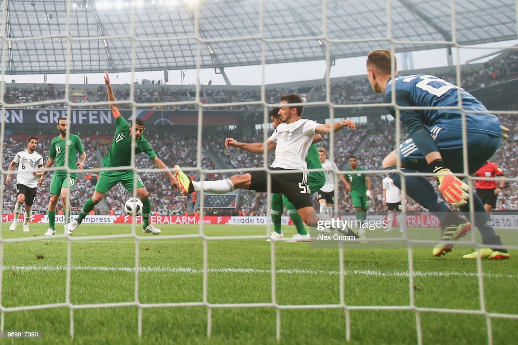 Taisir Al-Jassim #17 of Saudi Arabia scores his team's first goal past Mats Hummels and goalkeeper Marc-Andre ter Stegen of Germany during the international friendly match between Germany and Saudi Arabia ahead of the FIFA World Cup Russia 2018 at BayArena on June 8, 2018 in Leverkusen, Germany.