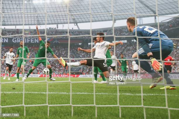 Taisir AlJassim of Saudi Arabia scores his team's first goal past Mats Hummels and goalkeeper MarcAndre ter Stegen of Germany during the...