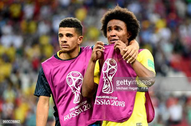 Taison of Brazil consoles teammate Willian of Brazil following their sides defeat in the 2018 FIFA World Cup Russia Quarter Final match between...