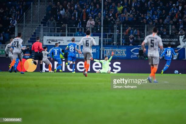 Taison of Donetsk scores his team's second goal past goalkeeper Oliver Baumann of Hoffenheim during the UEFA Champions League Group F match between...