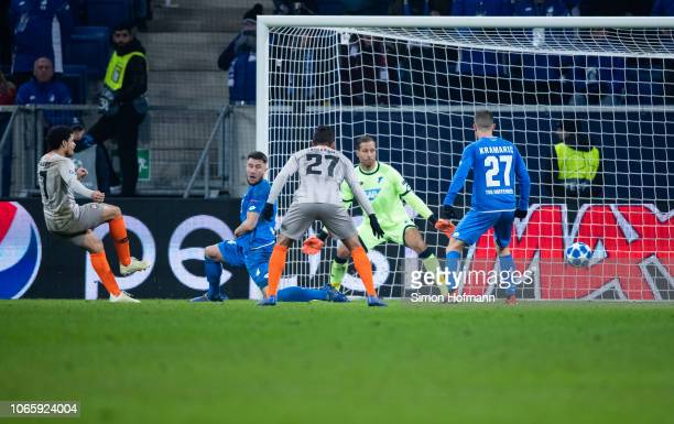 Taison of Donetsk scores his team's third goal past goalkeeper Oliver Baumann of Hoffenheim during the UEFA Champions League Group F match between...