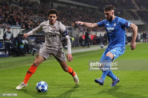 Taison of FC Shakhtar Donetsk challenges Ermin Bicakcic of TSG 1899 Hoffenheim during the Group F match of the UEFA Champions League between TSG 1899...