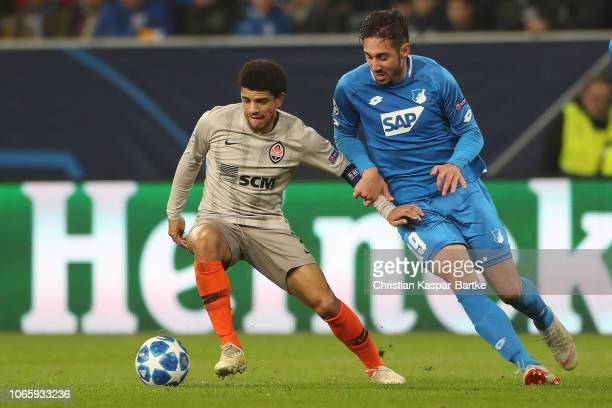 Taison of FC Shakhtar Donetsk challenges Ishak Belfodil of TSG 1899 Hoffenheim during the Group F match of the UEFA Champions League between TSG 1899...