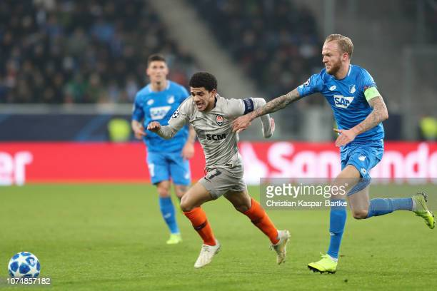 Taison of FC Shakhtar Donetsk challenges Kevin Vogt of TSG 1899 Hoffenheim during the Group F match of the UEFA Champions League between TSG 1899...