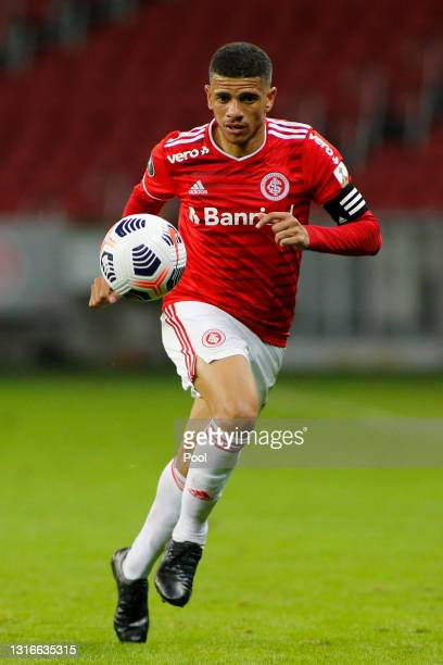 Taison of Internacional drives the ball during a match between Internacional and Olimpia as part of Group B of Copa CONMEBOL Libertadores 2021 at...