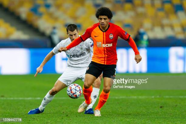 Taison of Shakhtar Donetsk and Stefan Lainer of Borussia Moenchengladbach battle for the ball during the UEFA Champions League Group B stage match...