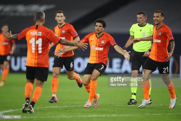 Taison of Shakhtar Donetsk celebrates with teammates after scoring his sides second goal during the UEFA Europa League Quarter Final between Shakhtar...