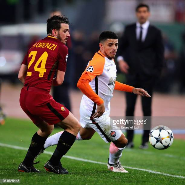 Taison of Shakhtar Donetsk is challenged by Alessandro Florenzi of AS Roma during the UEFA Champions League Round of 16 Second Leg match between AS...